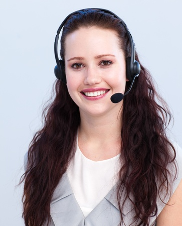 Portrait of beautiful woman working in a call center photo