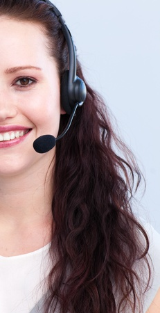 Smiling woman working with a headset on Stock Photo - 10075508