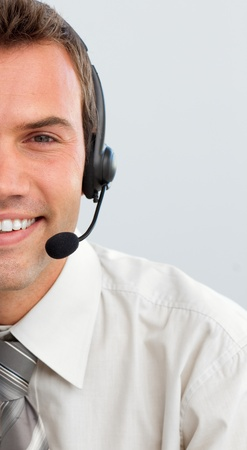 Attractive businessman with a headset on Stock Photo - 10075324