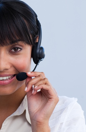 Close-up of smiling ethnic businesswoman working in a call center photo