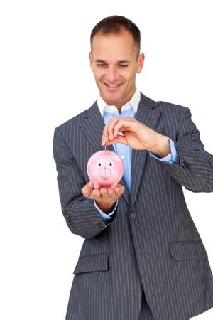 Charismatic businessman saving money in a piggybank  photo