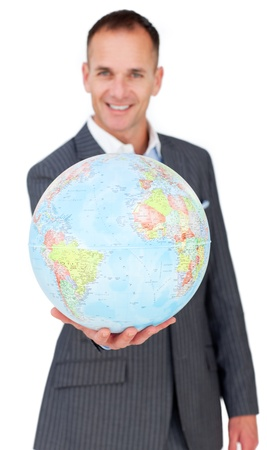 online internet presence: Cheerful businessman holding a terreatrial globe