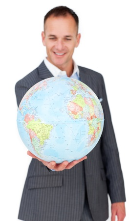 online internet presence: Self-assured businessman smiling at global business expansion