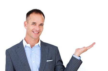 Smiling businessman showing a copyspace  photo