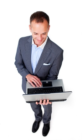 Concentrated businessman using a laptop Stock Photo - 10075515