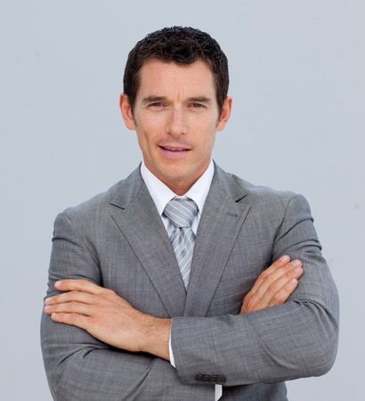 Portrait of smiling businessman with folded arms photo
