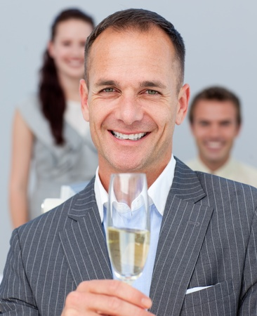 Cheerful businessman toasting with Champagne Stock Photo - 10089138