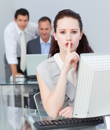 Businesswoman asking for silence in the office Stock Photo - 10087433