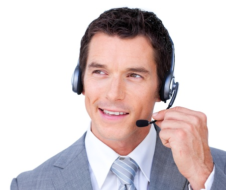 Confident young businessman using headset  Stock Photo - 10075570