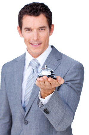 Smiling businessman holding a service bell  photo