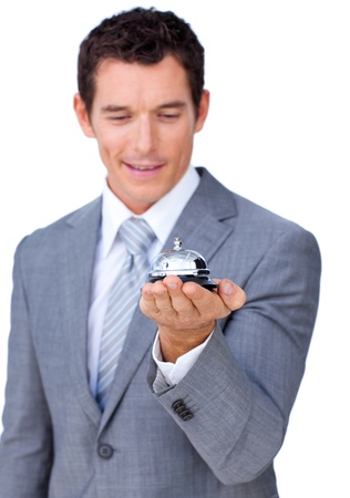 Attractive caucasian businessman showing a service bell  photo