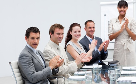 Business people applauding a colleague after reporting to sales figures Stock Photo - 10087677