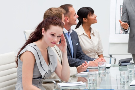 Businesswoman getting tired in a meeting photo