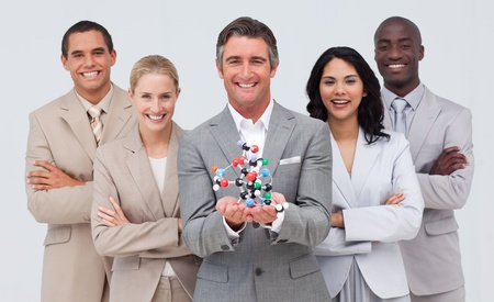 Business people holding a molecule model. Scince and business concept photo