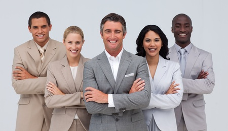 Confident business team standing and smiling Stock Photo - 10088556