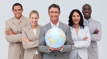 terrestrial globe: Business team holding a terrestrial globe Stock Photo