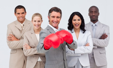 powe: Smiling businessman with boxing gloves leading his team