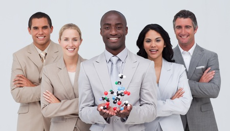 Business team holding a molecule model. Scince and business concept photo