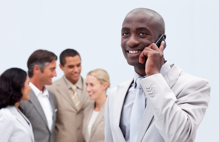 Afro-American businessman talking on mobile phone photo