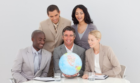 businessmeeting: Business team holding a terrestrial globe Stock Photo