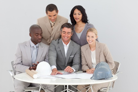 Architectural business people studying plans photo