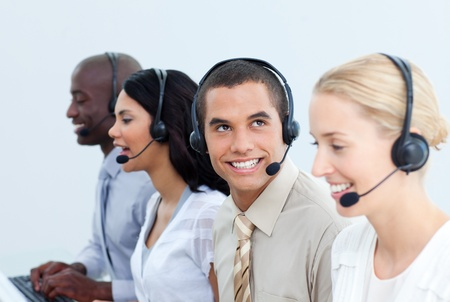Smiling business people working in a call center photo