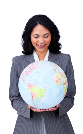 Young businesswoman holding a globe photo