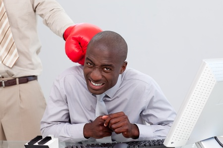 Afro-American businessman being boxed Stock Photo - 10088471