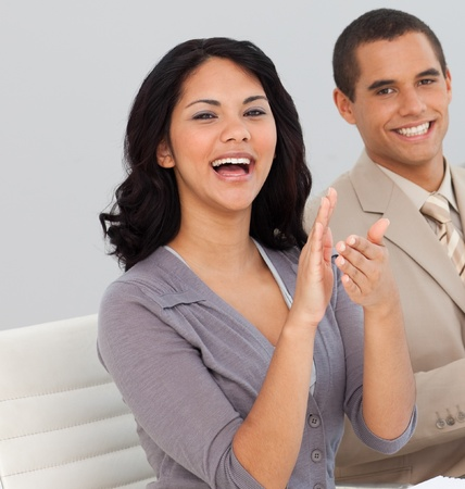 Business people at a presentation clapping Stock Photo - 10075357