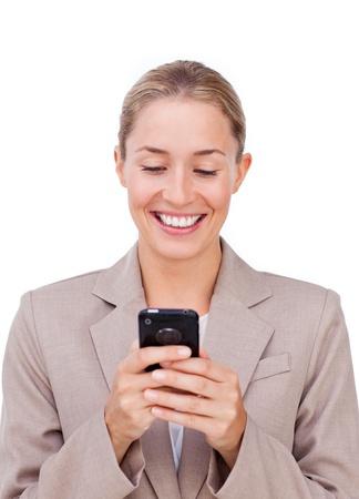 Positive businesswoman sending a text Stock Photo - 10089041