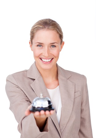 hotel service: Radiant businesswoman holding a bell