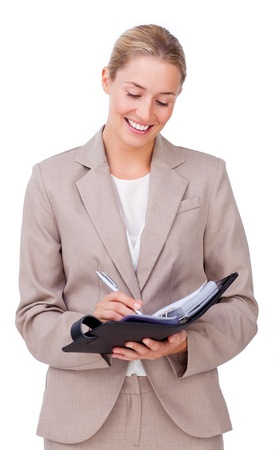 Young businesswoman making notes on her agenda  photo