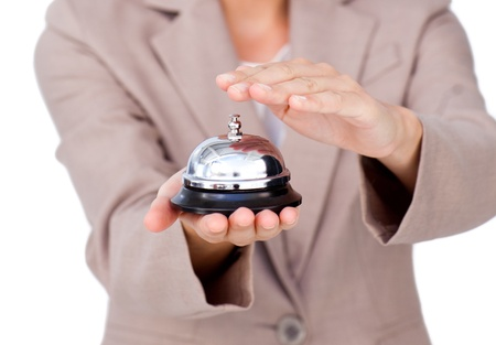 Close-up of a businesswoman using service bell  photo
