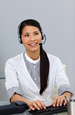 Ethnic businesswoman with headset on  photo