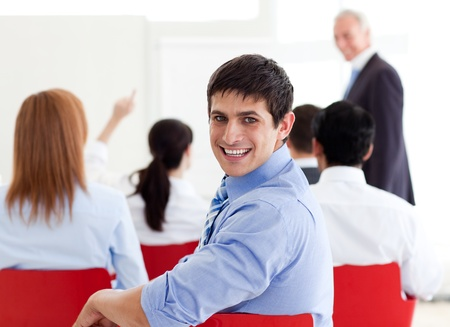Attractive businessman smiling at the camera Stock Photo - 10089647