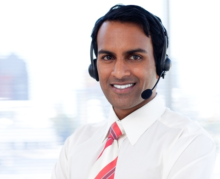 Portrait of a smiling businessman with headsets on photo