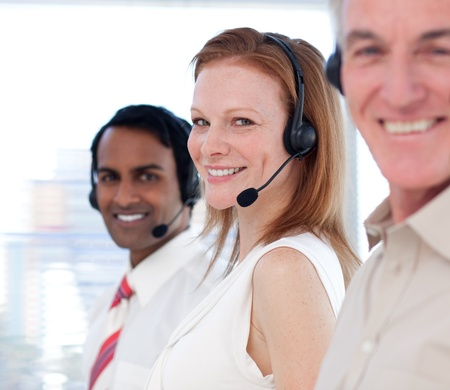 Business team working in a call center photo