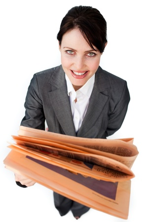 assertive: Assertive businesswoman reading a newspaper