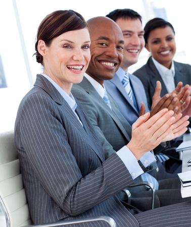 job promotion: International business team clapping a good presentation Stock Photo