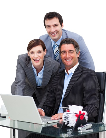 Merry business team working at a computer photo