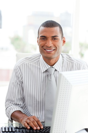 Ethnic businessman at a computer photo