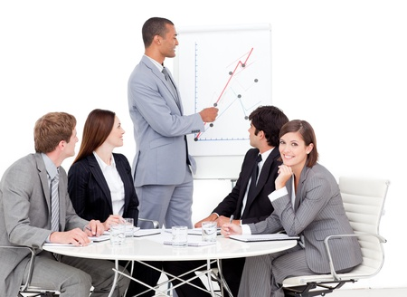 Confident businessman reporting sales figures Stock Photo - 10090227