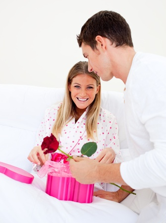 gstring: Attractive husband giving a present to his wife