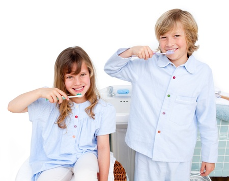 powder room: Brother And Sister Washing Their Teeth