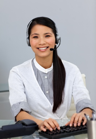 Ethnic customer service representative with headset on  photo
