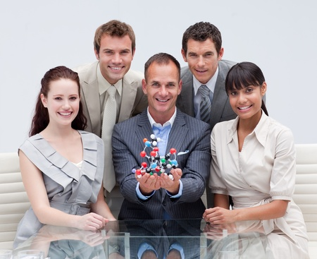 Business team holding molecules. Scientific business photo