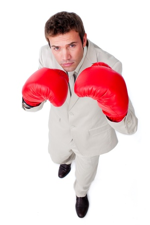 Cute businessman using boxing gloves Stock Photo - 10090617