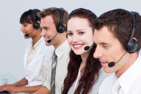 Woman working with more people in a call center photo