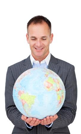 online internet presence: Confident businessman smiling at global business expansion