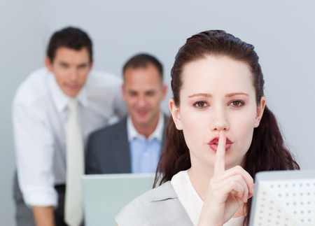 Portrait of a businesswoman asking for silence in the office Stock Photo - 10090379